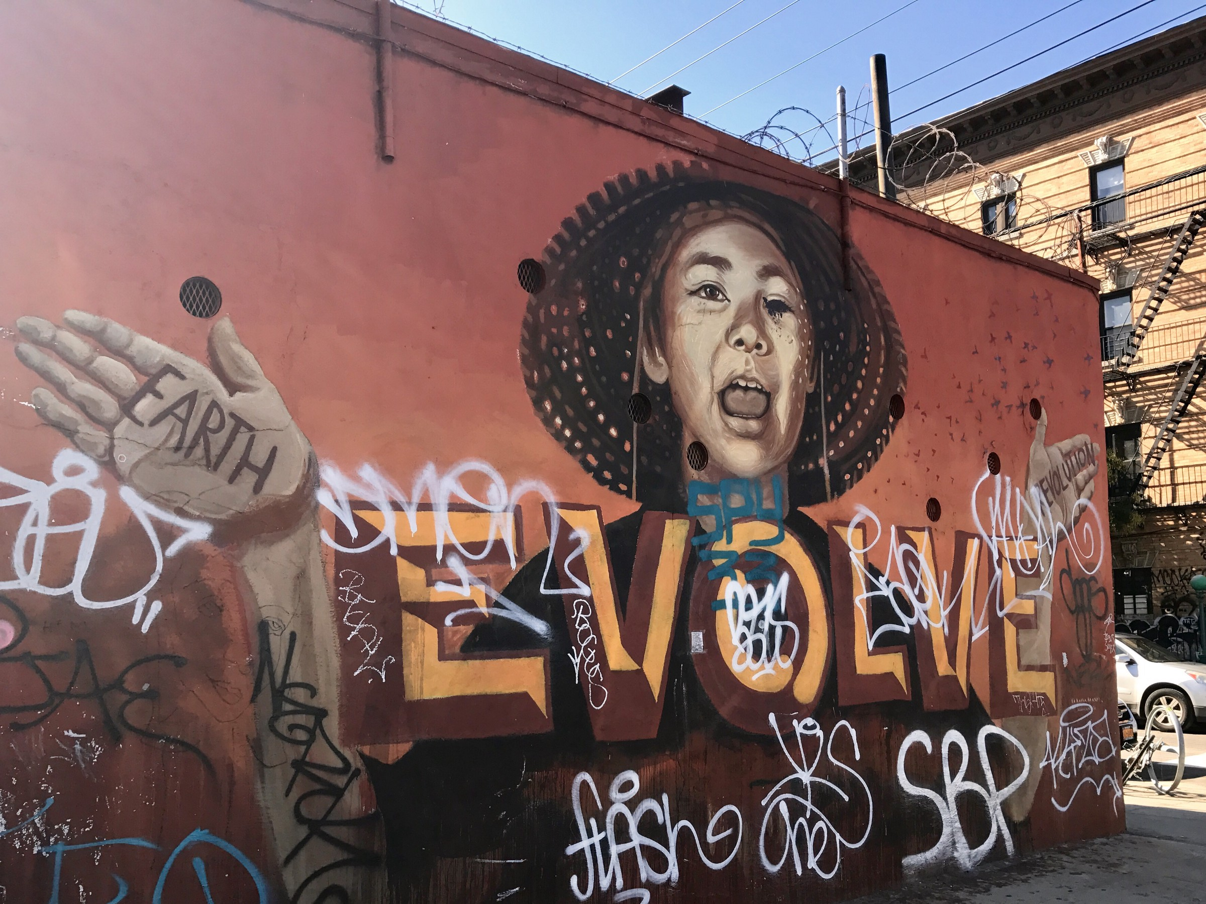 The mural by lmnopi that zexor defaced it now carries her word evolve people other than zexor are still vandalizing it today photo by natasha rodriguez