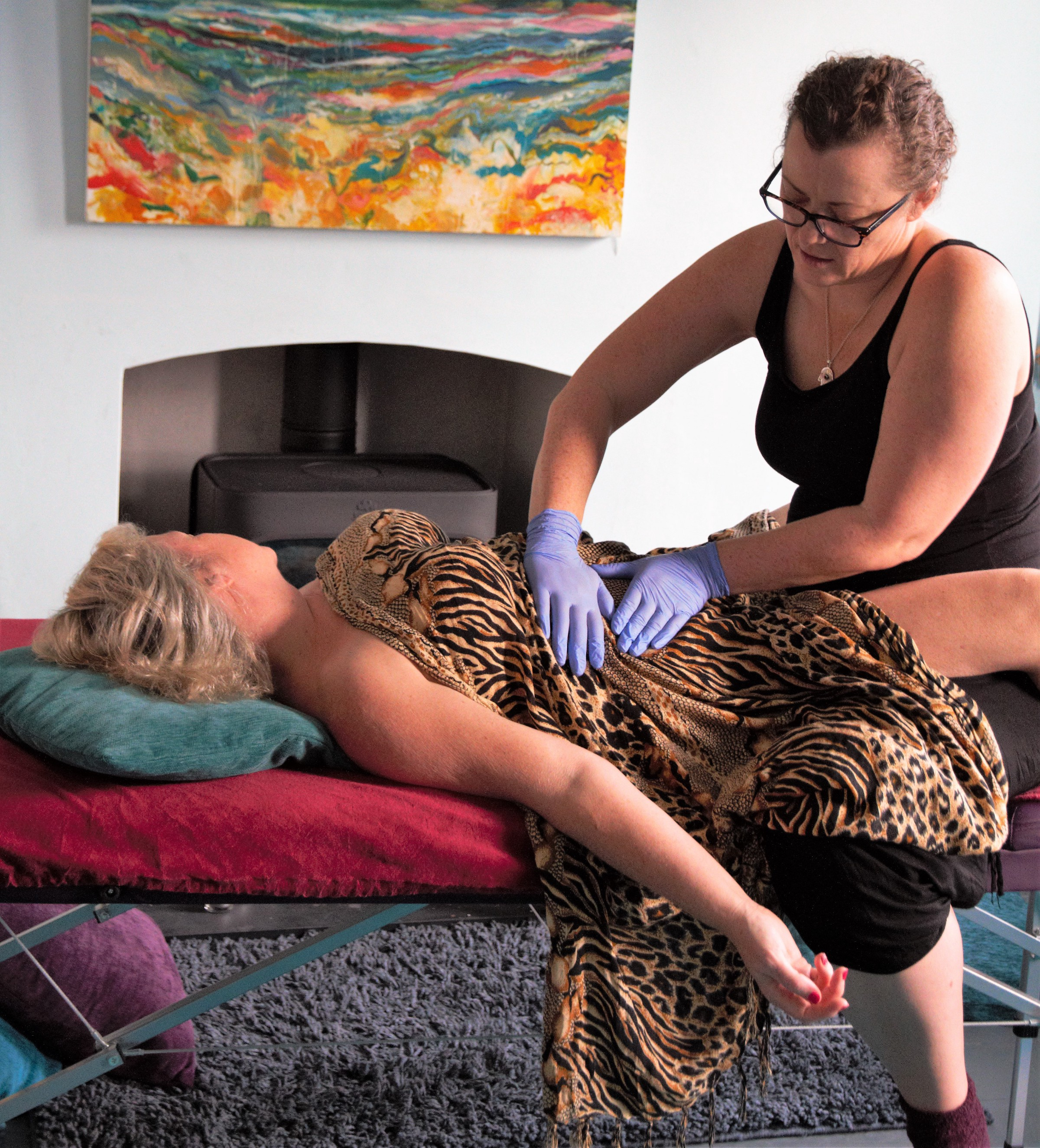 A soothing belly massage being given to a client