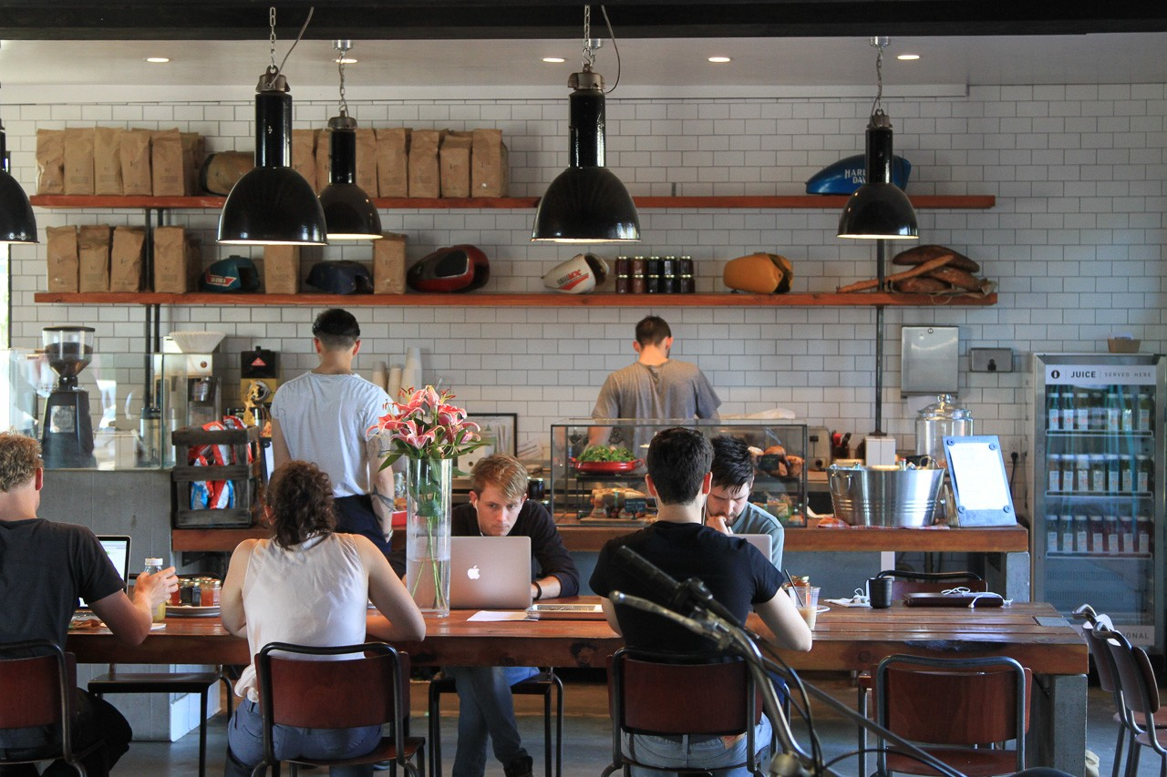 What are people working on in coffee shops?