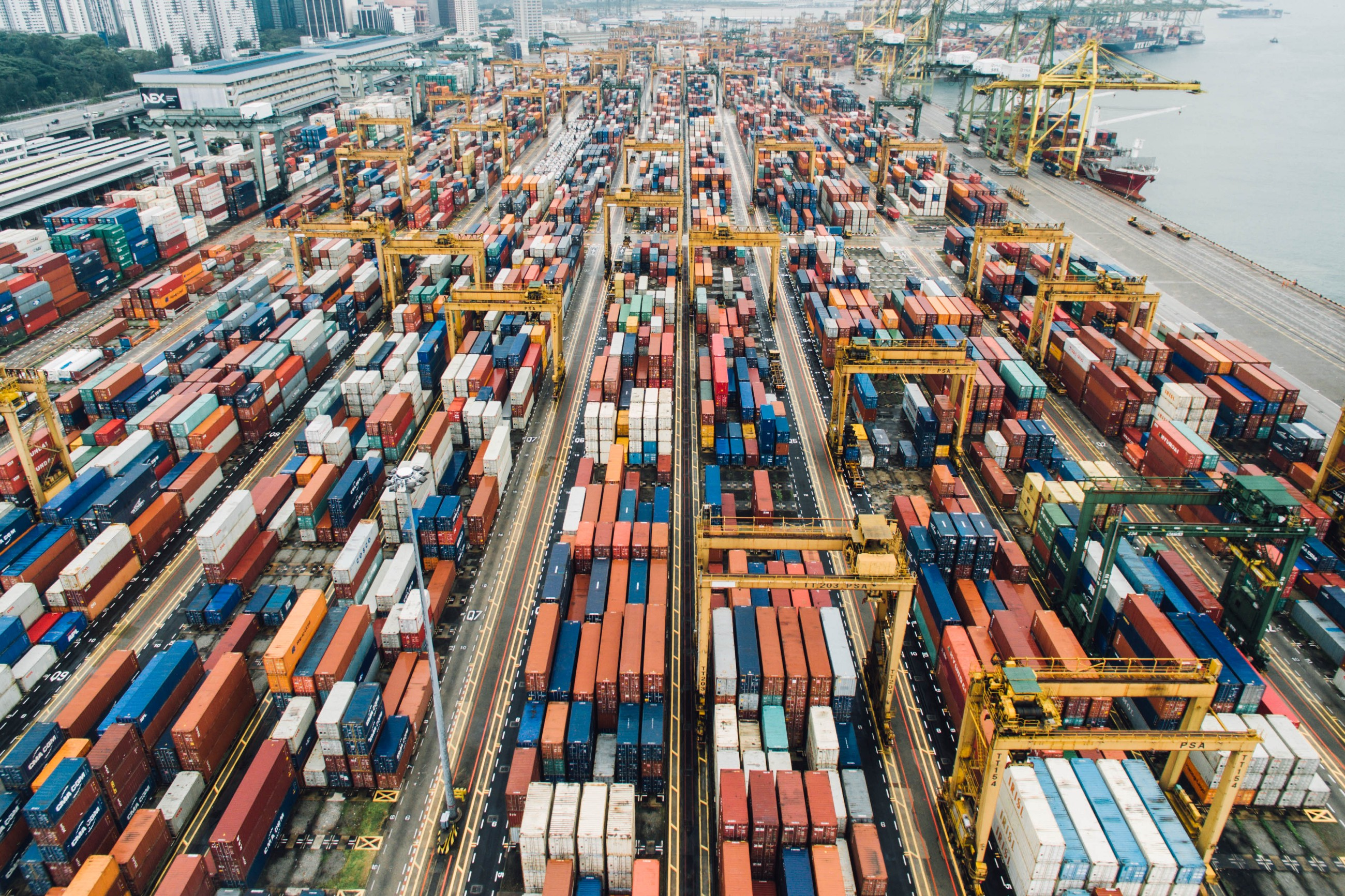 """A large number of shipping containers"" by chuttersnap on Unsplash"