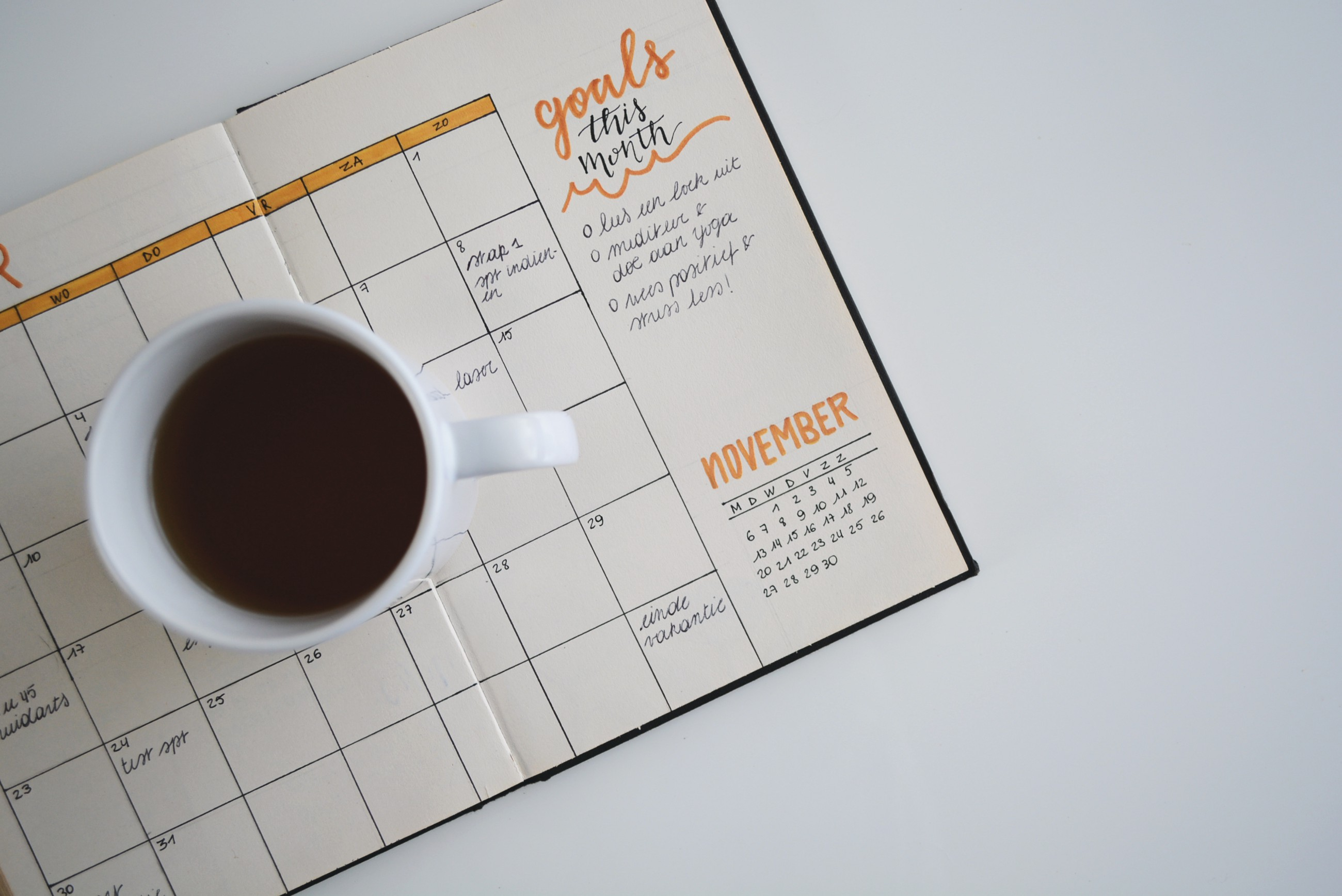 Coffee mug on planner