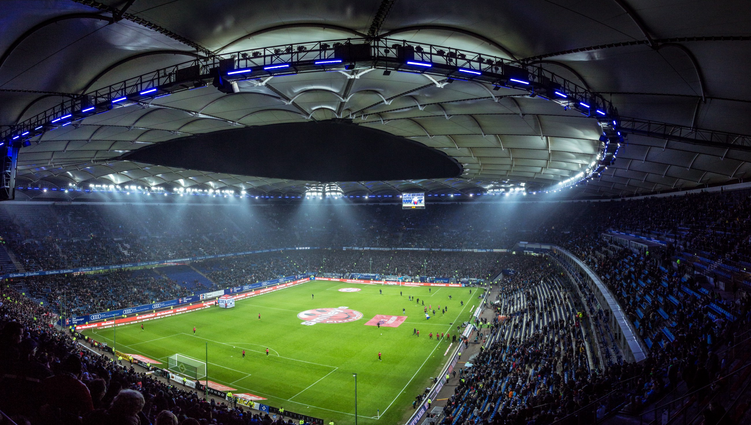 """""""Night view of crowded Volksparkstadion soccer stadium before the match at night"""" by Mario Klassen on Unsplash"""