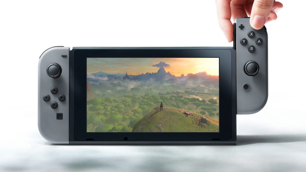 A person detaching one of the joycons from the Nintendo Switch