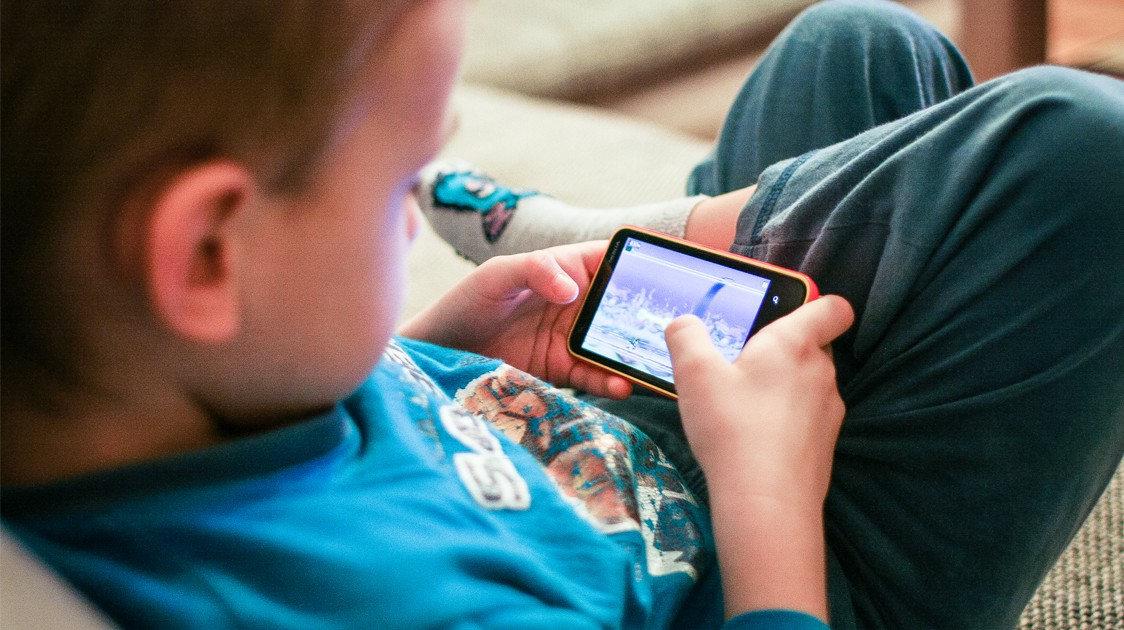 Image result for child with game phone