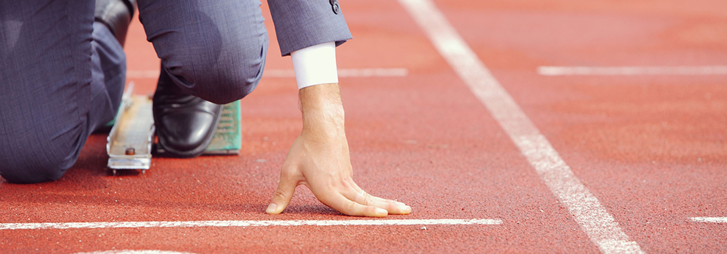 63b6dabf5e6 A man in a suit about to start a race. Admit that you couldn't have found a  better stock image for this post…