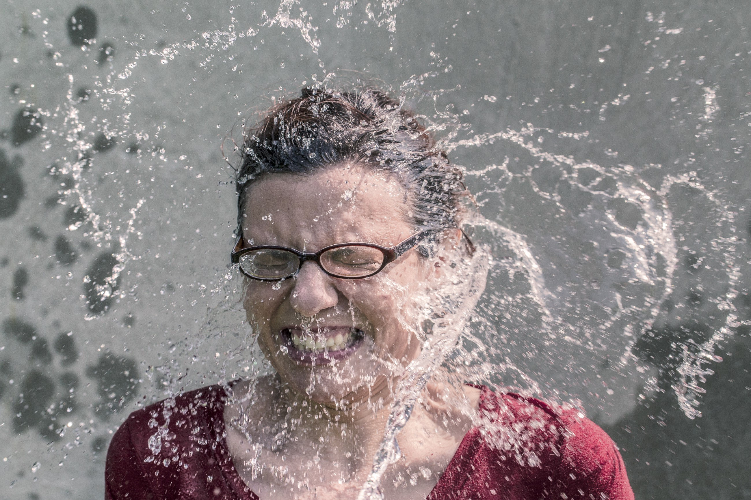 water splashing in woman's face