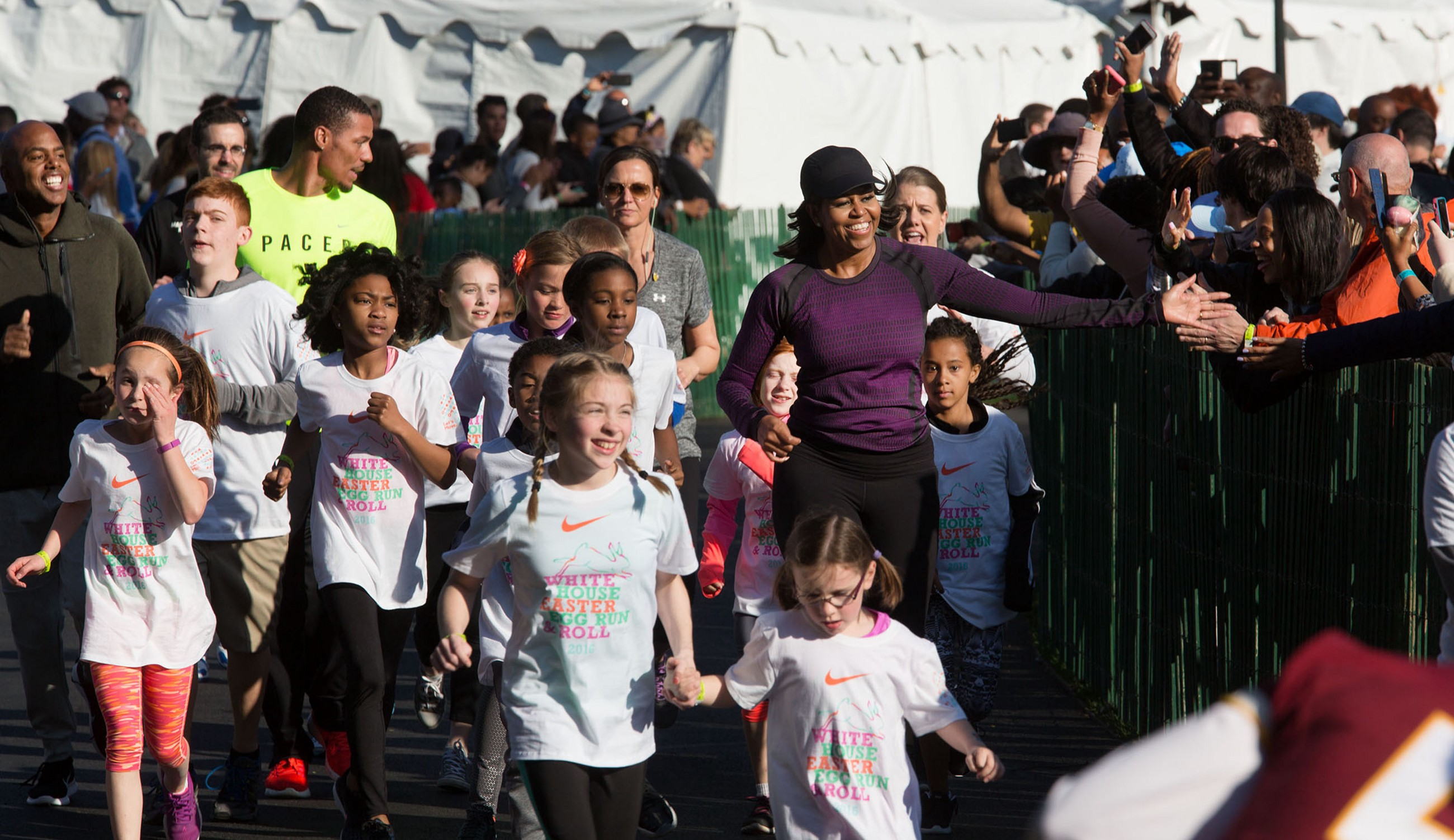 25cb452d3f2b First Lady Michelle Obama participates in the final heat of the Fun Run  during the annual Easter Egg Roll on the South Lawn of the White House