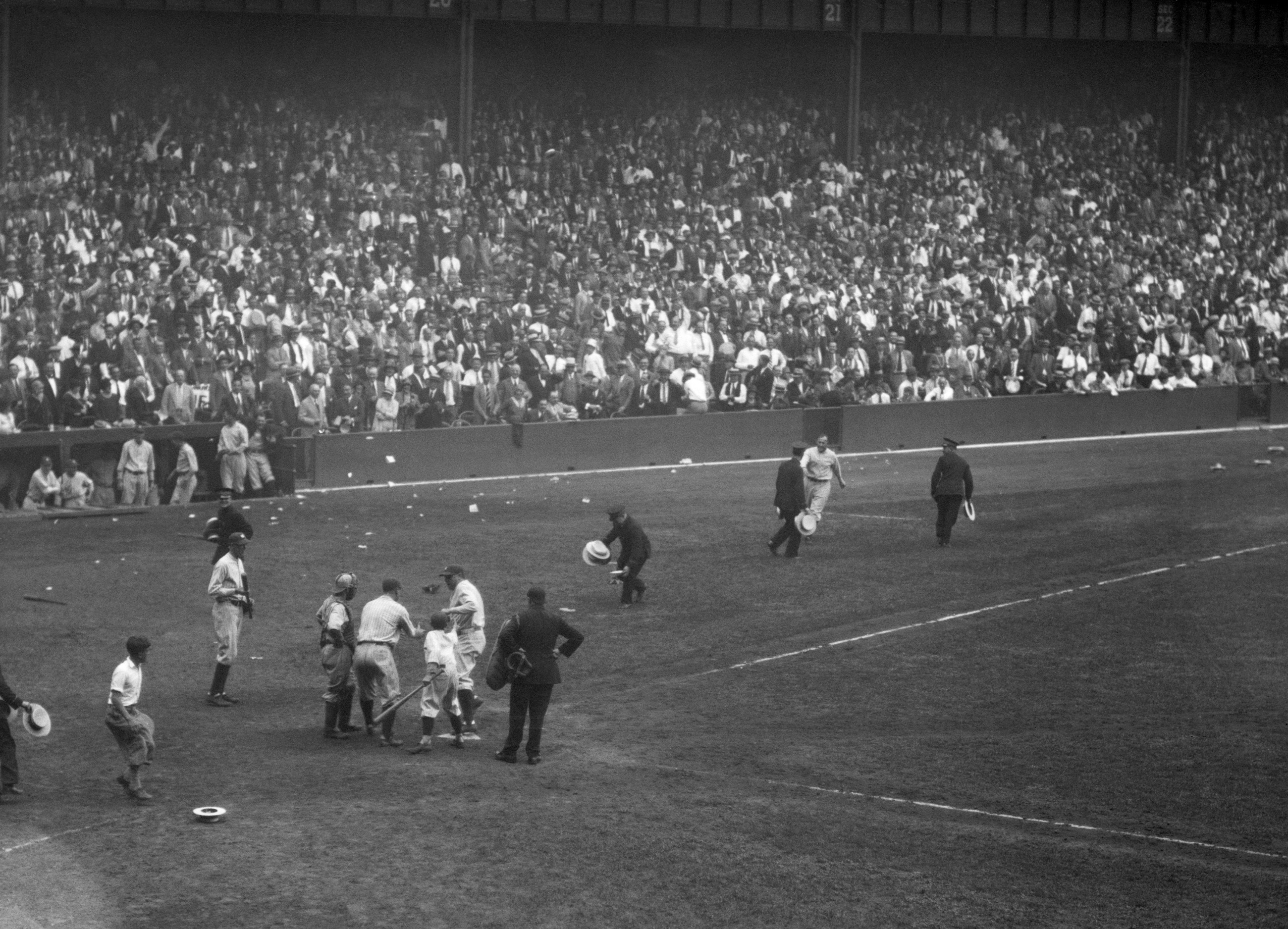 Yankee fans toss straw hats onto the field at Yankee Stadium after Babe Ruth  homers. 640e7e7bfc2b