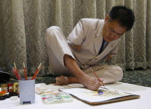 Man painting with toes