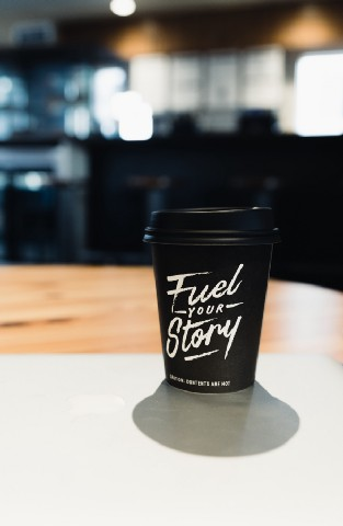 header photo of a coffee cup with great copywriting reminder to 'fuel your story'