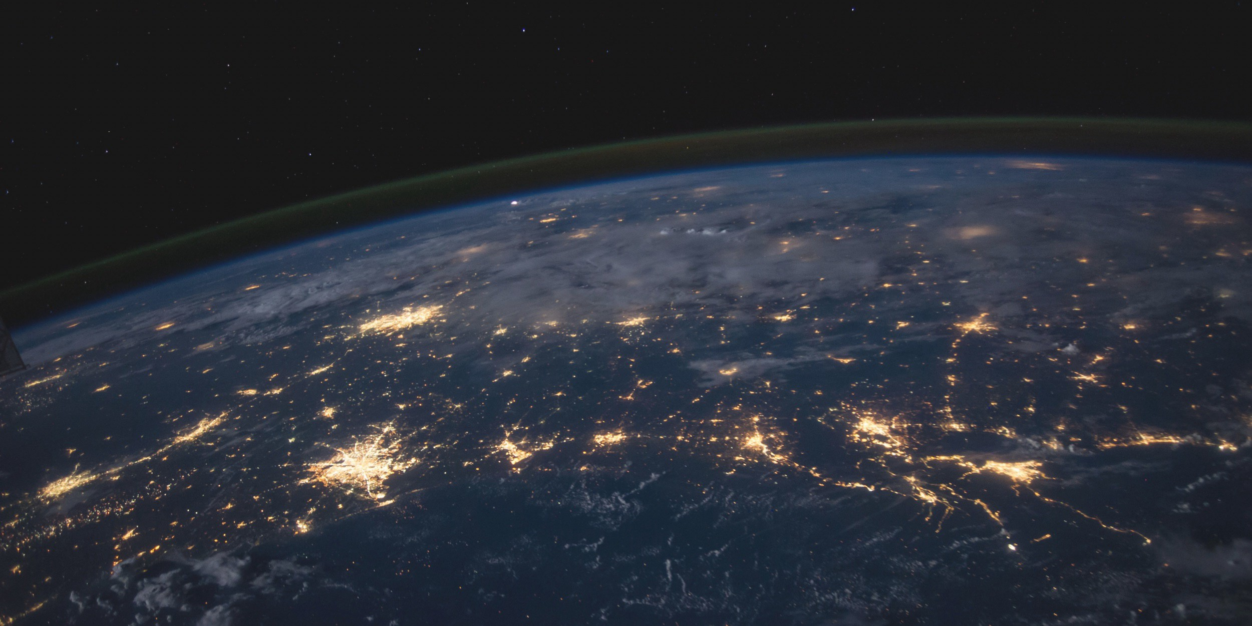 An outer-space view of the Earth showing electronic communications networks