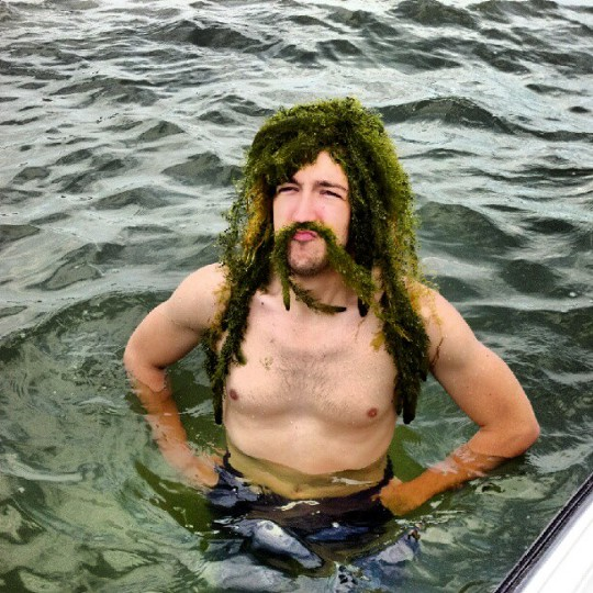 Man with seaweed in hair