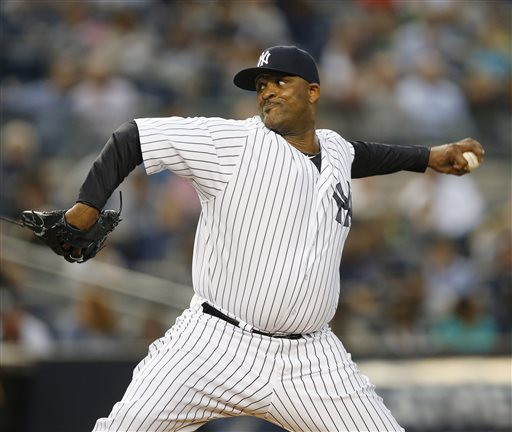 New York Yankees starting pitcher CC Sabathia (52) delivers in the first inning of a baseball game against the Miami Marlins at Yankee Stadium in New York, Thursday, June 18, 2015.  (AP Photo/Kathy Willens)