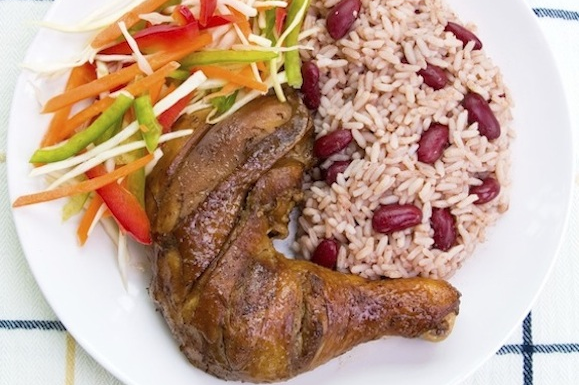 Jamaican sunday dinner the meal that says it all the meal that a sample of a typical jamaican sunday dinner plate this plate includes rice and peas stewed chicken and a small variety of vegetables forumfinder Image collections