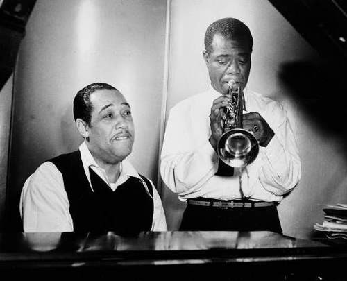 """Duke Ellington at the piano and Louis Armstrong on trumpet rehearse Leonard Feather's """"Long, Long Journey"""" during a session at the RCA Victor recording studio in New York Jan. 12, 1946. (AP Photo)"""