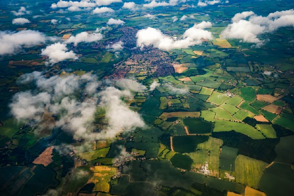 an aerial photo of a green, patchwork landscape