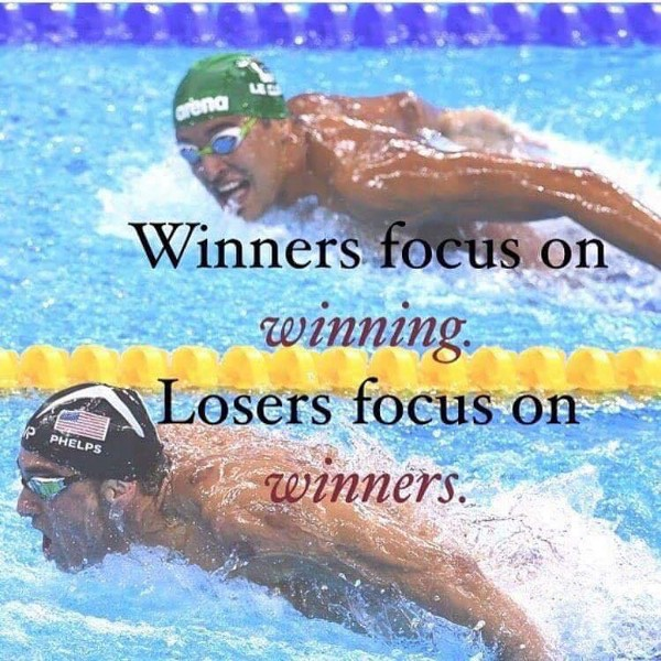 "Le Clos looking over at Phelps with text ""Winners focus on winning. Losers focus on winners."""