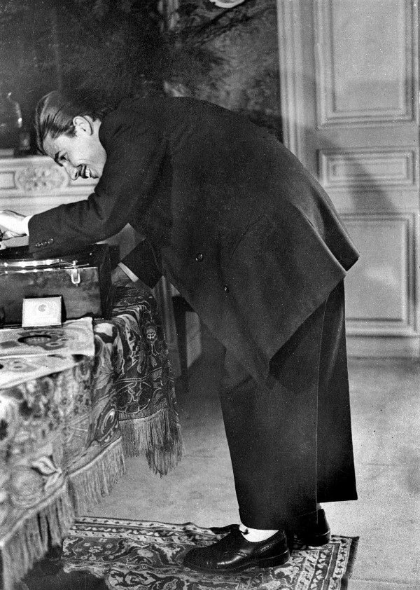 1 Zazou woman in typical attire. 2 A young zazou playing records on his gramophone, during World War II. (Albert Harlingue/Roger Viollet/Getty Images)