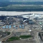 Suncor's Millenium heavy upgrader plant across Athabasca River from old reclaimed tailings pond