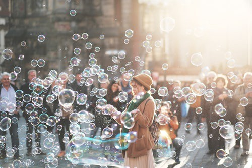 Girl smilling in bubbles