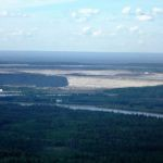 Syncrude's Steep Bank tailings pond dike towering over Athabasca River