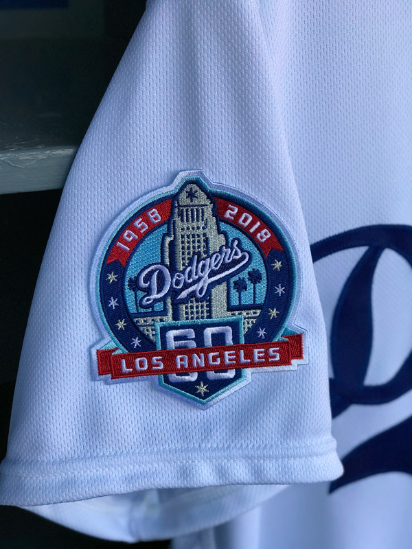Dodgers unveil 60th anniversary logo dodger insider the focal point of the logo is los angeles iconic city hall building which was the tallest building in the city when the dodgers moved from brooklyn in altavistaventures Image collections