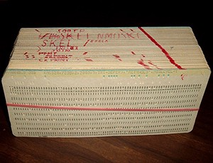 Image of a stack of punch cards comprising a computer program