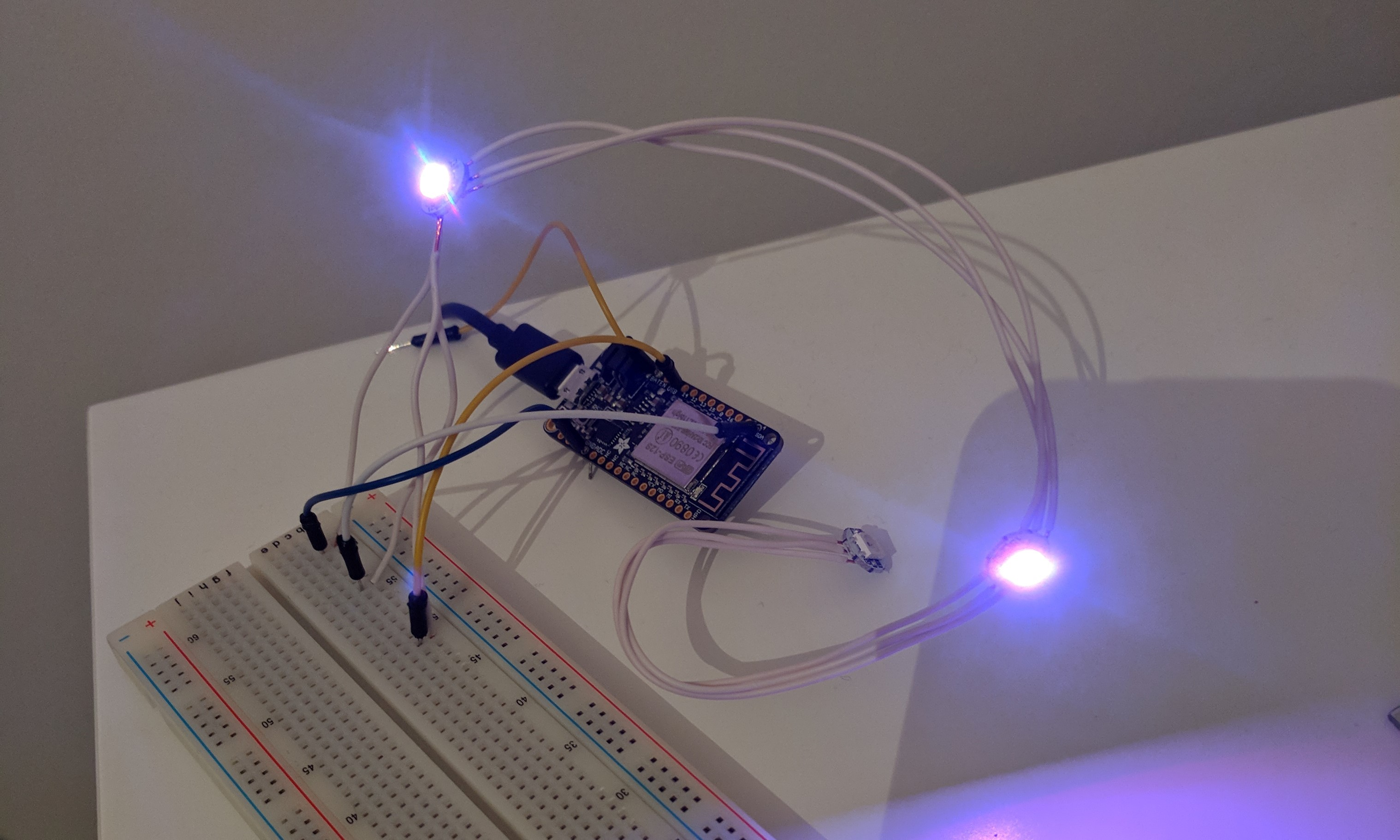 Connecting individual pixel LEDs to the Adafruit Feather using a breadboard.