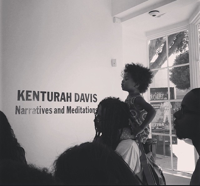 Father and daughter at artist talk with kenturah davis at papillion art gallery photo by danielle hall 2014
