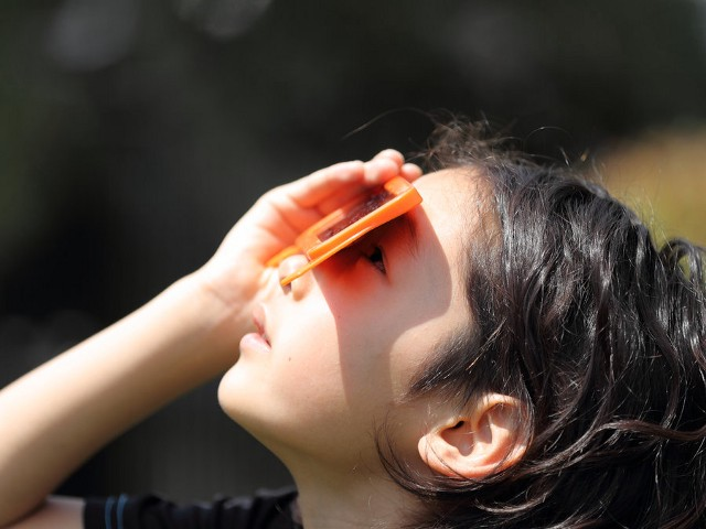 girl viewing eclipse