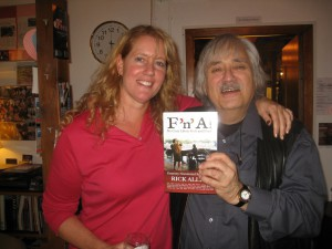 Katrina Hammond and Rick Allen's friend, Herbert, in Holland. Both are holding a copy of Allen's book, 'F 'n' A! My Crazy Life in Rock and Blues.'