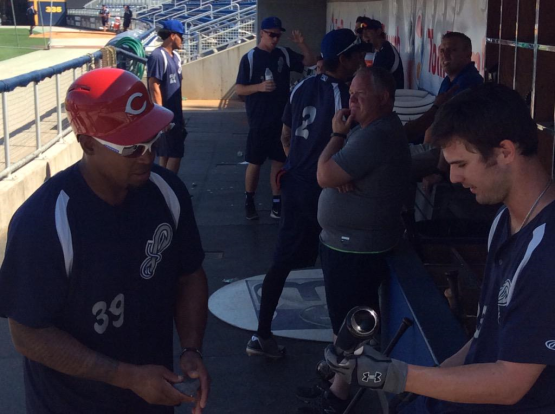 Marlon Byrd speaks with Jesse Winker in the Blue Wahoos dugout before batting practice Wednesday.
