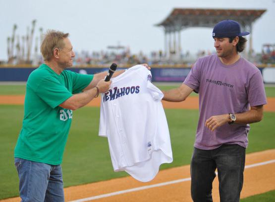 Bubba Watson receives a jersey from Blue Wahoos owner Quint Studer before a first pitch in 2012.