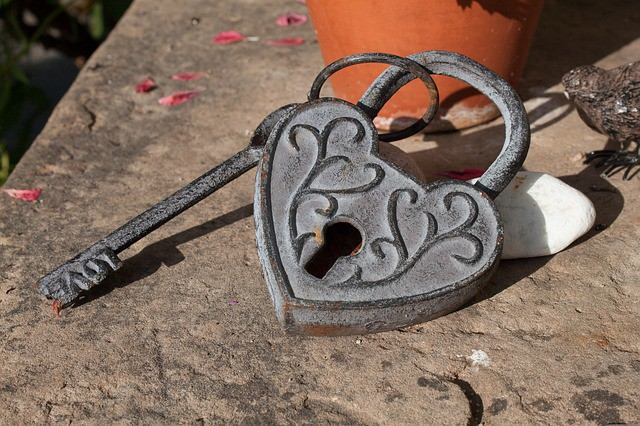Antique heart-shaped lock with an iron key