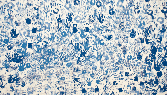 Blue hand prints on wall - All our opportunities, freedoms and technical advances were earned by the efforts of those who came before us.