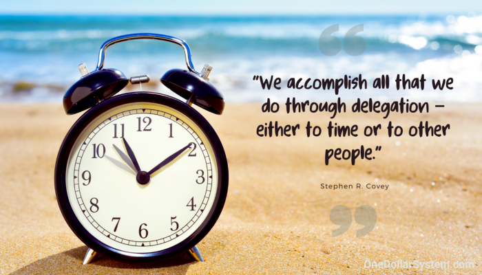 """Clock on the beach, sunny day, """"We accomplish all that we do through delegation - either to time or to other people"""" Stephen R. Covey"""