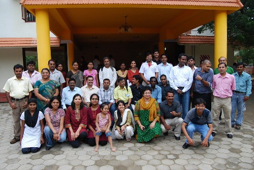 Participants of the first Rang De Field Partner Meet take a group photo. Approximately 40 people participated in the meet.