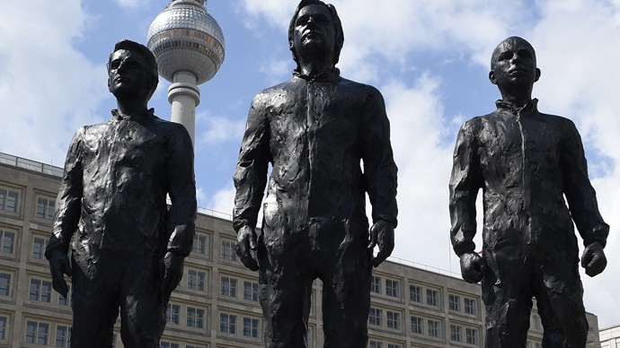 Julian Assange, Edward Snowden and Chelsea Manning at Berlin's Alexanderplatz