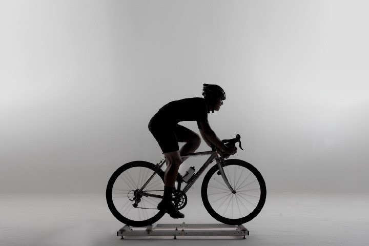 Cyclist on a bicycle indoors