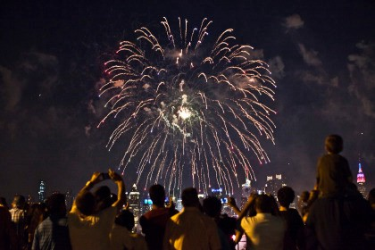 WEEHAWKEN, NJ - JULY 4: People watch fireworks light up the sky over New York City on July 4, 2013 in Weehawken, New Jersey. July 4th is a national holiday with the nation celebrating its 238th birthday. (Photo by Kena Betancur/Getty Images)