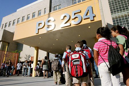 Parents and their children are lined up outside PS 254 in Richmond Hill, Queens, on the first day of school for New York City's public schools.