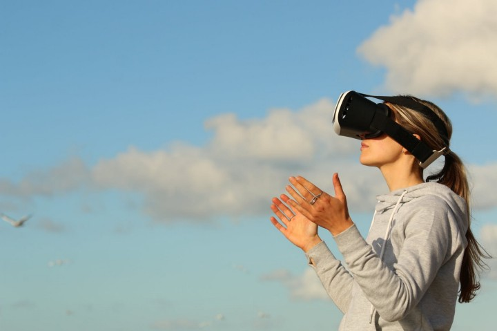 Woman outdoors using VR goggles