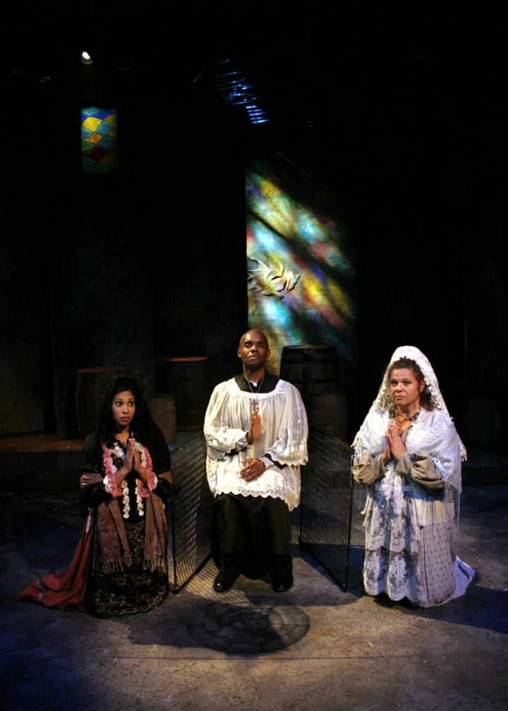 Mala Bhattacharya, Kenneth Harmon and Ellen Peterson kneeling and praying in Man of La Mancha