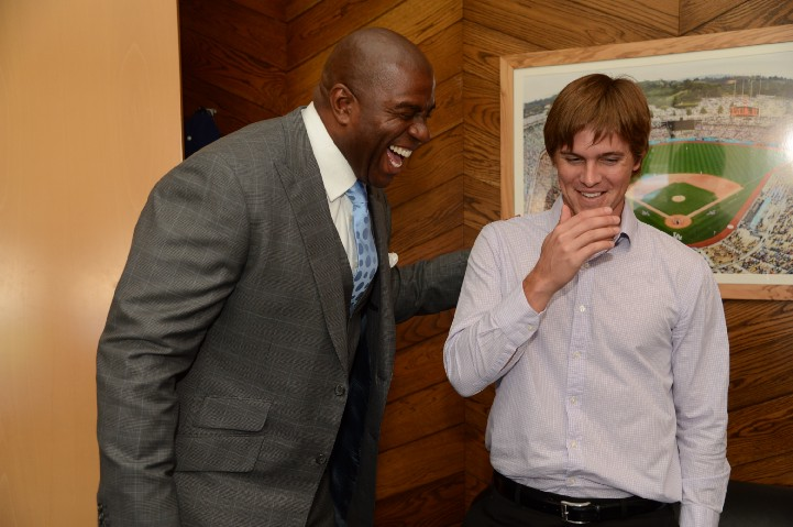 Magic Johnson welcomes Zack Greinke to the Dodgers on December 11, 2012. (Jon SooHoo/Los Angeles Dodgers)