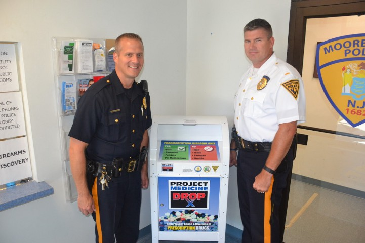 Left to right, Officer Walt Walczak and Lt. Howard Mann Jr. stand beside the newly implemented drug drop box.