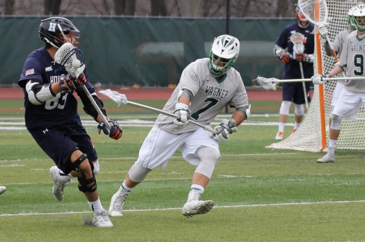 Sean Gray, seen here playing for Wagner College, wards off a Hobart defender. Sean completed his college career at Wagner in 2016. He was the first Seneca boys' lacrosse player to accept an athletic scholarship from a Division I school.