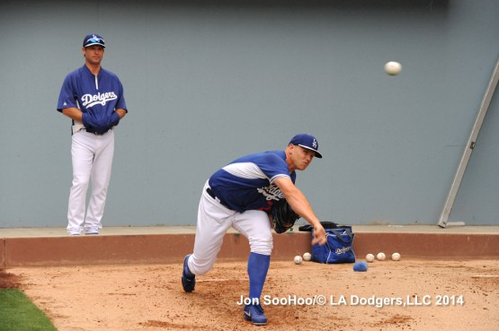 Bullpen coach Chuck Crim watches Seth Rosin on Tuesday.