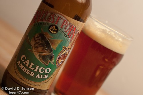 Bottle of Ballast Point Calico Amber Ale and a glass of beer