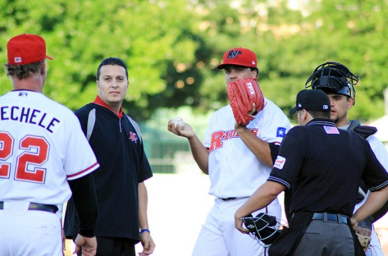 Carlos Olivas (second from the left) pays a medical visit to RoughRiders pitcher Carlos Pimentel. (Alex Yocum-Beeman)