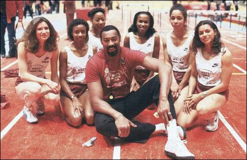 Wilt Chamberlain with some track ladies
